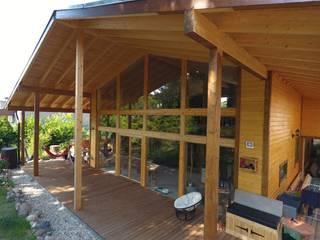 Balcones y terrazas escandinavas de THULE Blockhaus GmbH - Ihr Fertigbausatz für ein Holzhaus Escandinavo