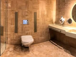 REFORMA HOTEL PALM BEACH | SEASIDE RÖ | ARQUITECTOS Baños de estilo moderno Piedra Ámbar/Dorado