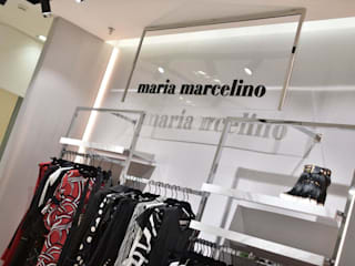Maria Marcelino: Lojas e espaços comerciais  por Cervus Concept & Retail,Moderno
