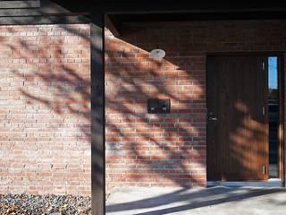自然公園の森に面した家 の 家と草木のアトリエ hausgras オリジナル
