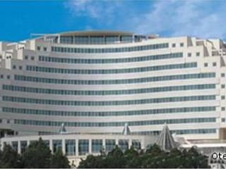 SERPİCİ's Mimarlık ve İç Mimarlık Architecture and INTERIOR DESIGN Hotel in stile mediterraneo Granito Bianco
