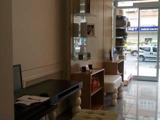 SERPİCİ's Mimarlık ve İç Mimarlık Architecture and INTERIOR DESIGN Negozi & Locali commerciali moderni Legno Bianco