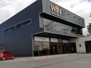 Centro deportivo Winfit, Chile Gimnasios domésticos de estilo industrial de Constructora Elisur Ltda Industrial