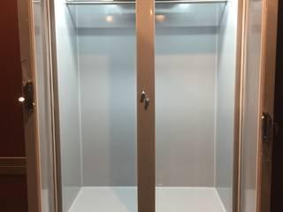 Шубный холодильник в сером цвете в гардеробной частного дома Beauty&Cold ГардеробнаяХранение Серый