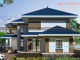 現代房屋設計點子、靈感 & 圖片 根據 Xây nhà trọn gói Hà Nội 現代風