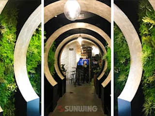 Fire-retardant Artificial green walls Moderne winkelruimten van Sunwing Industries Ltd Modern