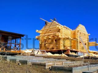 Деревянный дом ручной рубки от Строительная компания РЭСТ Классический