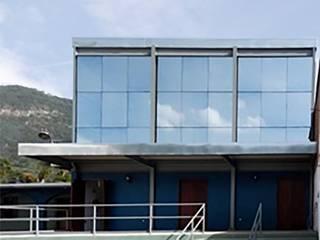 Templo Misión Salones minimalistas de Aldana Sánchez - Ingenieros Arquitectos Minimalista