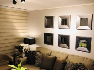 Iluminación con rieles y foco móviles Livings modernos: Ideas, imágenes y decoración de Oscar Saavedra Diseño y Decoración Spa Moderno