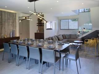 Salas de jantar modernas por Concepto Taller de Arquitectura Moderno