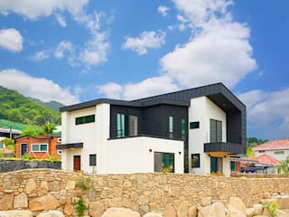 Classic style houses by 한글주택(주) Classic