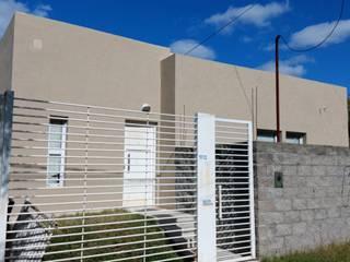 Vivienda Unifamiliar en Villa Elisa de Mc Govern estudio de arquitectura Moderno