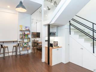 local comercial con escalera con almacenaje y muebles a medida Estudios y despachos de estilo industrial de Loema Reformas Integrales Madrid Industrial