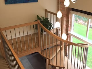 Spiral Staircase in Oak by Boss Stairs Limited Modern
