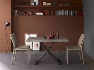 Un tavolo che scompare: il Tavolino Geniale, una soluzione multifunzionale per trasformare gli ambienti Sala da pranzo moderna di Mobili a Colori Moderno