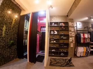 Loja Harfemen Espaços comerciais industriais por Monteiro arquitetura e interiores Industrial
