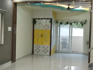 Villa Interiors @ Praneeth APR Pranav Antilia, Bachupally, Hyderabad Country style living room by SP Interiors Country