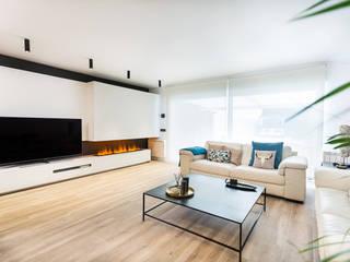 Planta baja de unifamiliar en Madrid Salones de estilo moderno de Estudio Arinni S.L. Moderno
