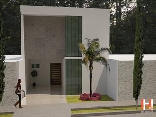 FACHADA CON CRISTAL Y CANTERA Casas modernas de HHRG ARQUITECTOS Moderno