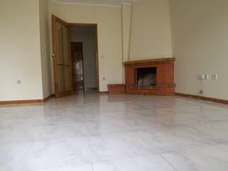 Remodelação de Apartamento em Braga por Belleville Imobiliária Moderno