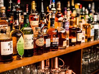 Hammer & Margrander Interior GmbH Bar & Club in stile eclettico Legno Marrone