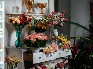 La floreale Bacoli Negozi & Locali commerciali in stile minimalista di manuarino architettura design comunicazione Minimalista