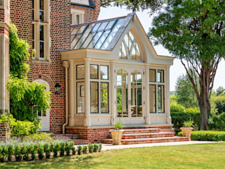 Large bespoke orangery with bronze windows and a tall decorative gable end Classic style conservatory by Vale Garden Houses Classic