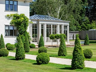 Bespoke orangery with full length glazed panels allow the owners to enjoy panoramic views of their beautiful garden Classic style conservatory by Vale Garden Houses Classic