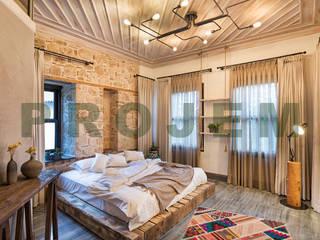 Гостиницы в средиземноморском стиле от Mimoza Mimarlık Средиземноморский