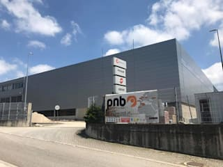 Edificio Industrial Manitowoc Crane Group Portugal, Lda Baltar/Parada, Paredes Escritórios industriais por rem-studio Industrial