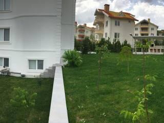 levent tekin iç mimarlık Jardins de fachadas de casas Concreto Verde