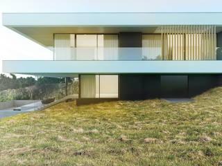 Modernistyczny jednorodzinny dom dwukondygnacyjny na skarpie od Budownictwo i Architektura Marcin Sieradzki - BIAMS