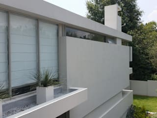 Minimalist house by Green Evolution Architecture Minimalist