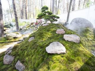 Геопластика в виде холмов с камнем от Студия ландшафтного дизайна Кости Юдина