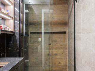 Studio super funcional e com muita personalidade Banheiros ecléticos por Studio Elã Eclético