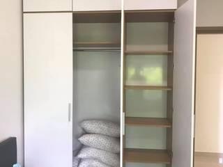 DỊCH VỤ THIẾT KẾ THI CÔNG CĂN HỘ NỘI THẤT 2 PHÒNG NGỦ TẠI HỒ CHÍ MINH: hiện đại  by OKIA Furniture, Hiện đại