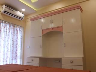 DLF CAPITAL GREENS, MOTI NAGAR Modern style bedroom by IMAGIC INTERIORS Modern