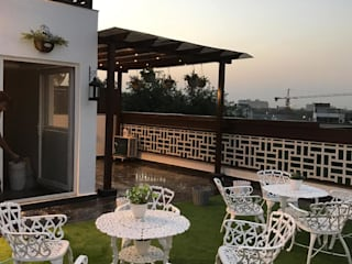 Terrace Garden - Escape from the busy delhi city life: tropical  by The Mystique Interiors,Tropical