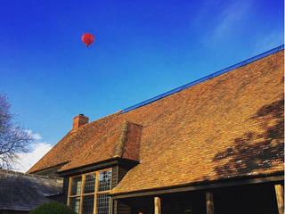 Huntercombe Manor Barn by Natralight Modern