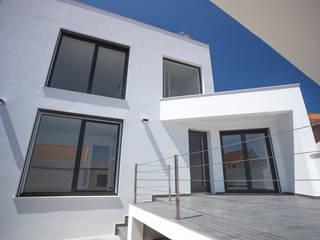 Fachada principal de Moradia unifamiliar - Silveira Torres, Vedras por Decor-in, Lda Moderno