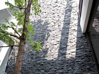 モダンな 壁&床 の Decorex モダン