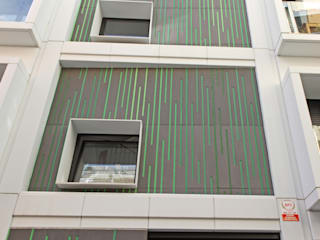 Construcción de edificio de viviendas de obra nueva de Xmas Arquitectura e Interiorismo para reformas y nueva construcción en Barcelona Moderno