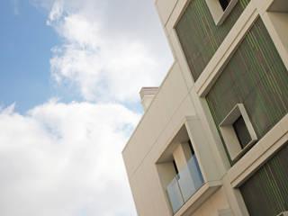 Construcción de edificio de viviendas de obra nueva Casas de estilo moderno de Xmas Arquitectura e Interiorismo para reformas y nueva construcción en Barcelona Moderno