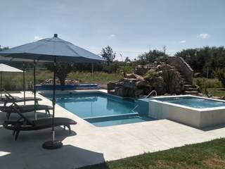 ALBERCA DE 10*5 ALBERCAS Y TERRAZAS Albercas de jardín Concreto reforzado Azul