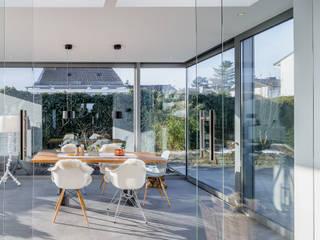 Jardines de invierno modernos de Scharrer Architektur GmbH Moderno