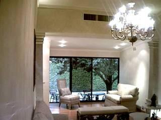 Elegancia en Interior Salones modernos de DIMARQ® espacios arquitectónicos Moderno