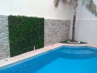 Muro verde artificial Remodelacion y acabados Centros comerciales de estilo tropical Plástico Verde