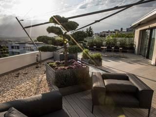 Modern Terrace by Füglistaller Architekten AG Modern