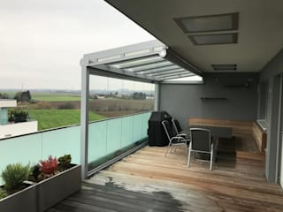 Varandas, marquises e terraços modernos por Schmidinger Wintergärten, Fenster & Verglasungen Moderno