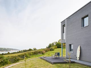 House Rushworth: Downsizing Project by Baufritz Baufritz (UK) Ltd. Jardin avant Bois Gris